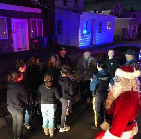 Christmas crime victims get assist from police playing Santa