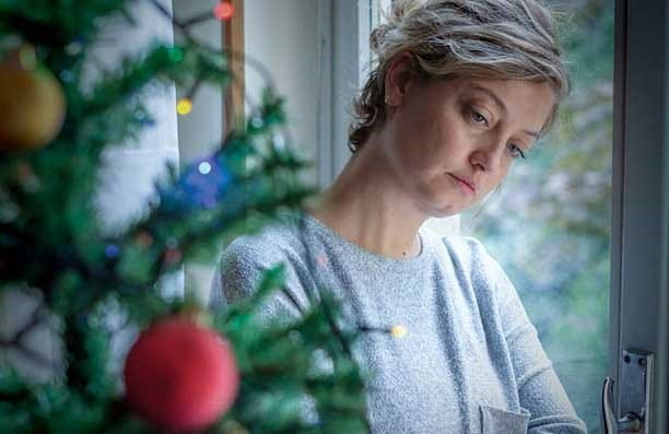 It's important for family members to reset their expectations when coping with the loss of a loved one during the holidays.