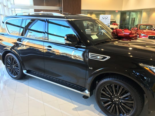 Infiniti of Northern Kentucky will put a lQX80 luxury SUV like this one atop the dealership's new 55-foot illuminated tower drivers can see from I-71/I-75 in Fort Wright.