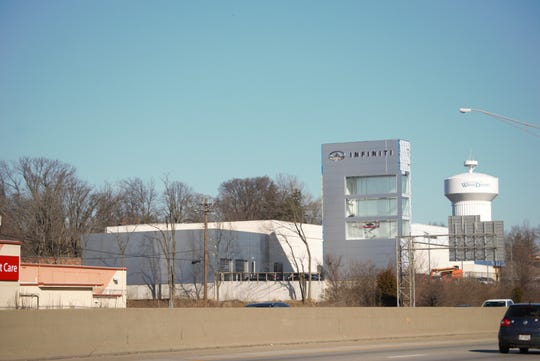 Dec. 26, 2018: The new 55-foot tower at Infiniti of Northern Kentucky in Fort Wright has window spaces to showcase three of the luxury car makers' vehicles to drivers on I-71/I-75.