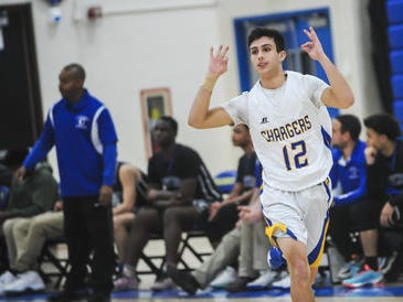 Spotswood's Michael Harris holds up three fingers after making a 3-point shot against Carteret on Wednesday, Dec. 19, 2018 at Spotswood.
