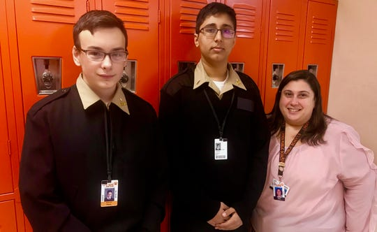 Paul Niziolek and Gurvir Singh with computer science teacher Holly Sepulveda.