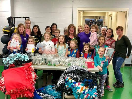 Volunteers make crafts for local seniors at Hillsborough YMCA.