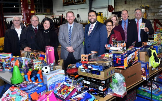 Union County Freeholder Chairman Sergio Granados and Freeholders Angel G. Estrada, Christopher Hudak, Rebecca Williams, Bruce H. Bergen and Alexander Mirabella joined Union County Deputy County Manager Amy Wagner, Union County Office of Community Engagement & Diversity Coordinator Nathalie Hernandez and Division of Strategic Planning and Intergovernmental Relations Division Director Phil Kandl in reviewing the toys donated by Union County employees and residents with the help of outside organizations during this year's toy drive. Toys were collected to provide holiday cheer to families across Union County. For the food drive, Union County employees donated over 1,000 pounds of food to the Community Food Bank of Hillside NJ. This year's Union County Holiday Giving Drives were organized by the Union County Office of Community Engagement & Diversity.