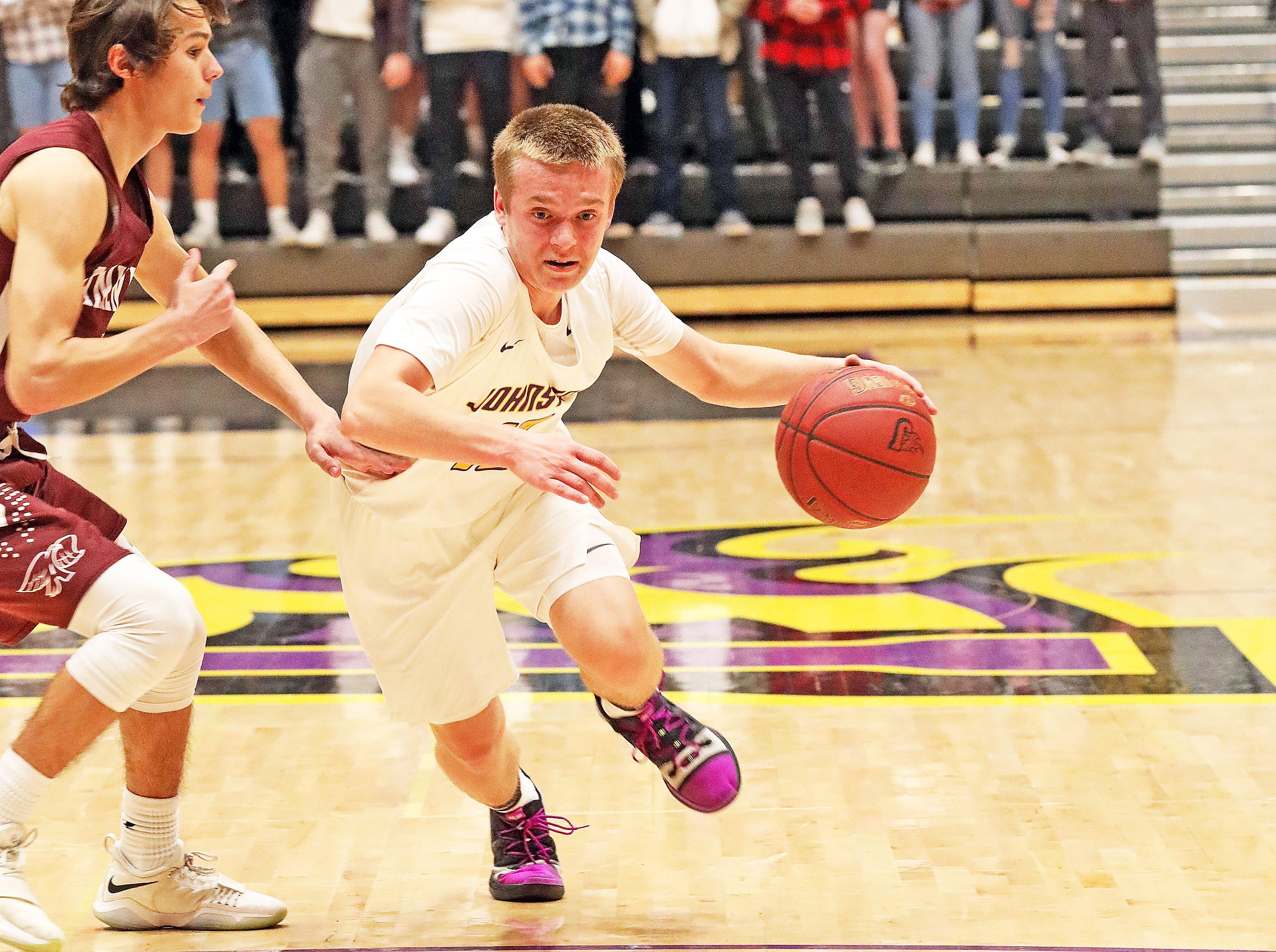 Johnston freshman Jacob Runyan heads towards the bucket as the Ankeny Hawks compete against the Johnston Dragons in high school basketball on Friday, Dec. 21, 2018 at Johnston High School.