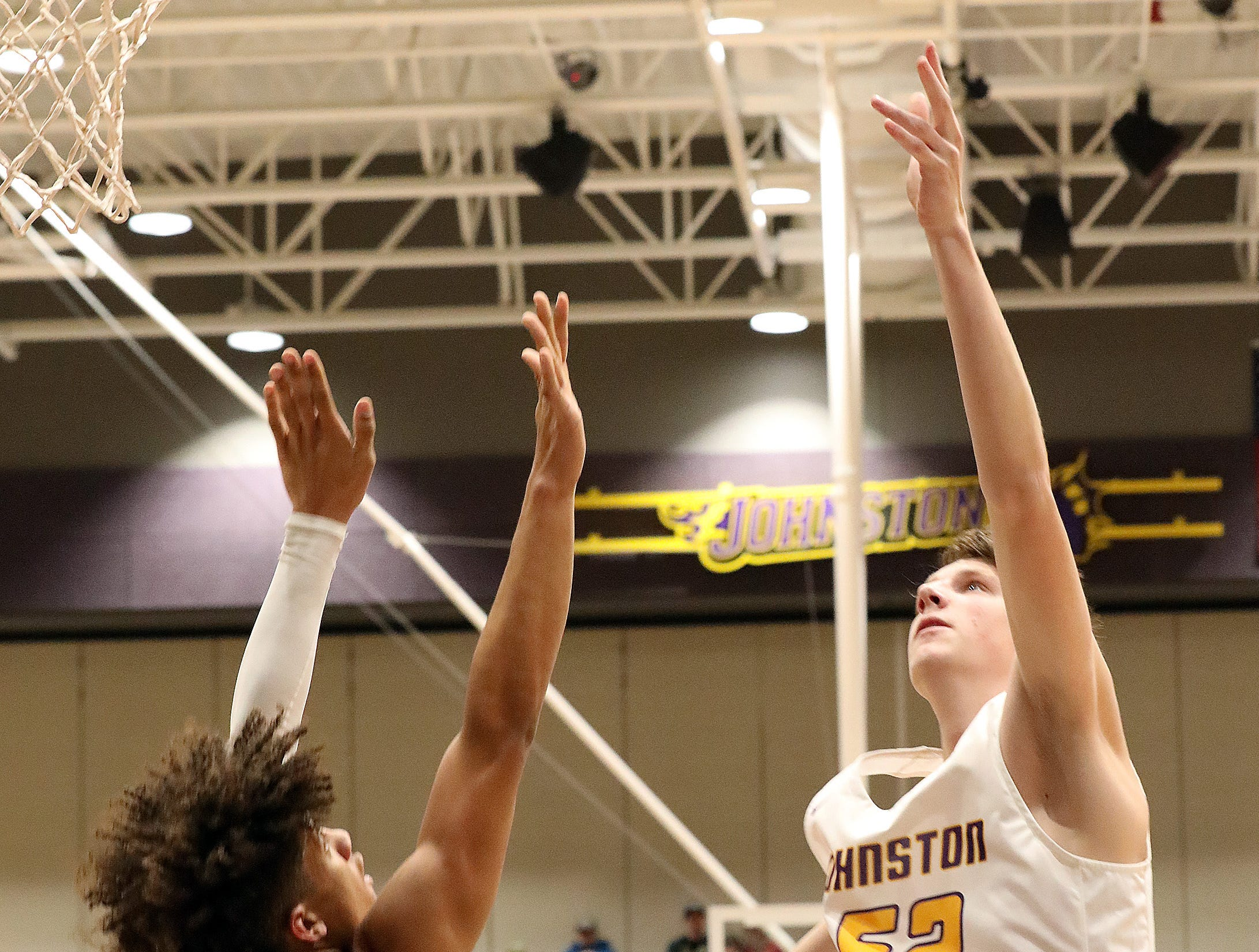 Johnston sophomore Max Roquet scores two points as the Ankeny Hawks compete against the Johnston Dragons in high school basketball on Friday, Friday, Dec. 21, 2018 at Johnston High School.