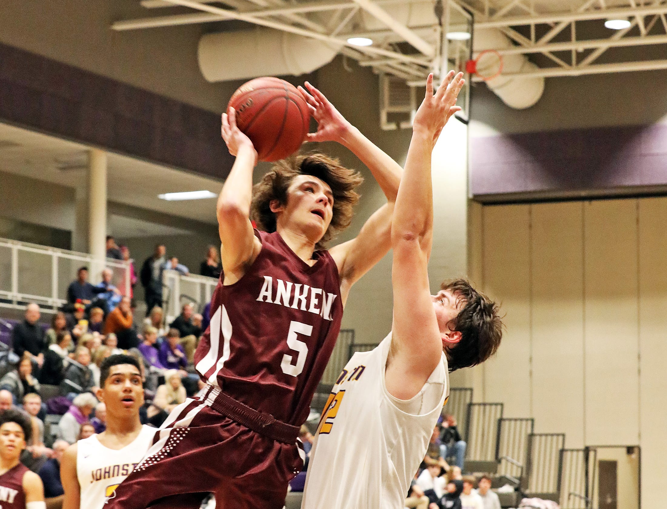 Ankeny senior Reece Pitz scores in the final period as the Ankeny Hawks compete against the Johnston Dragons in high school basketball on Friday, Dec. 21, 2018 at Johnston High School.