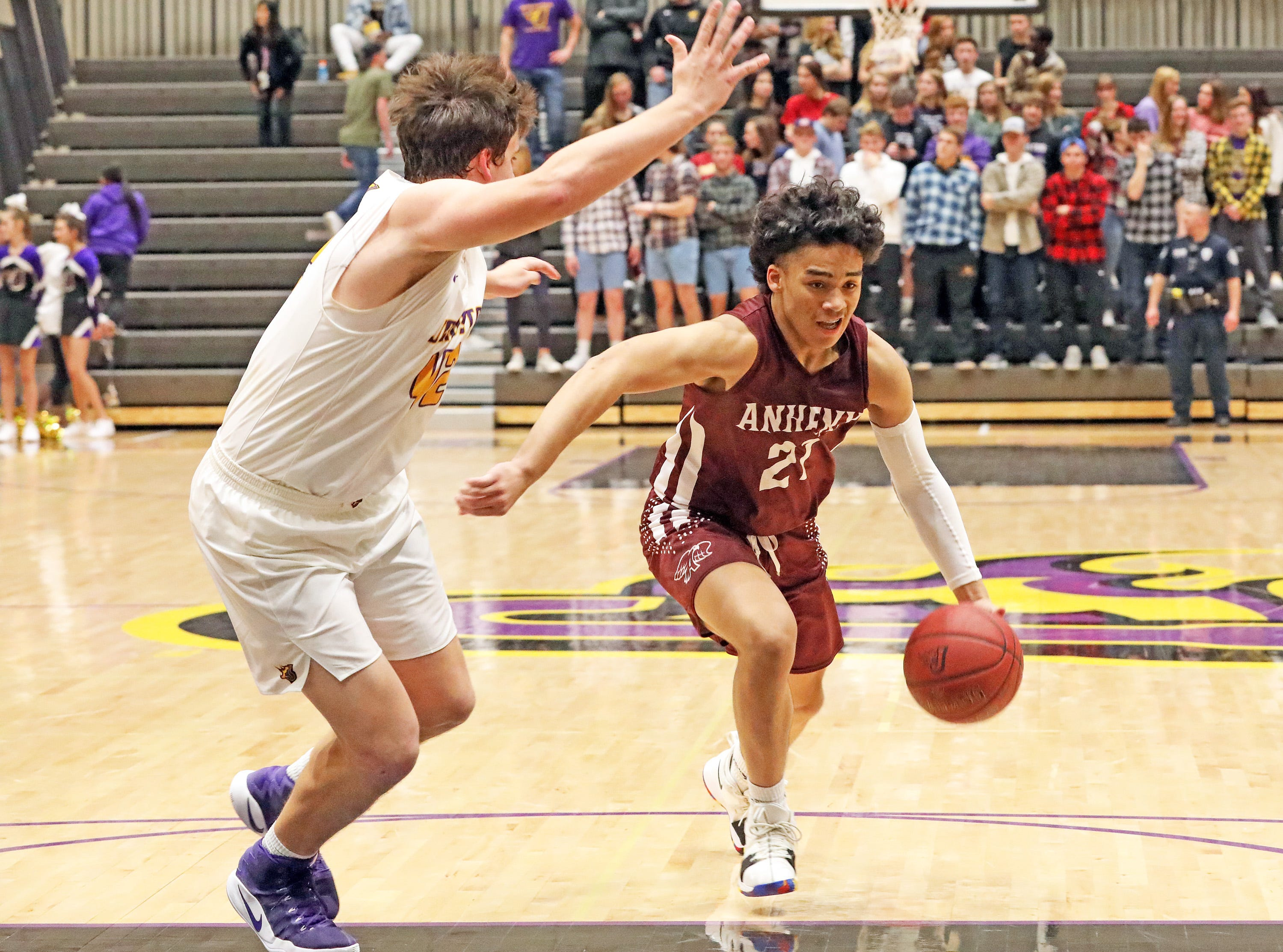 Ankeny sophomore JeRon Crews drives the lane as the Ankeny Hawks compete against the Johnston Dragons in high school basketball on Friday, Dec. 21, 2018 at Johnston High School.