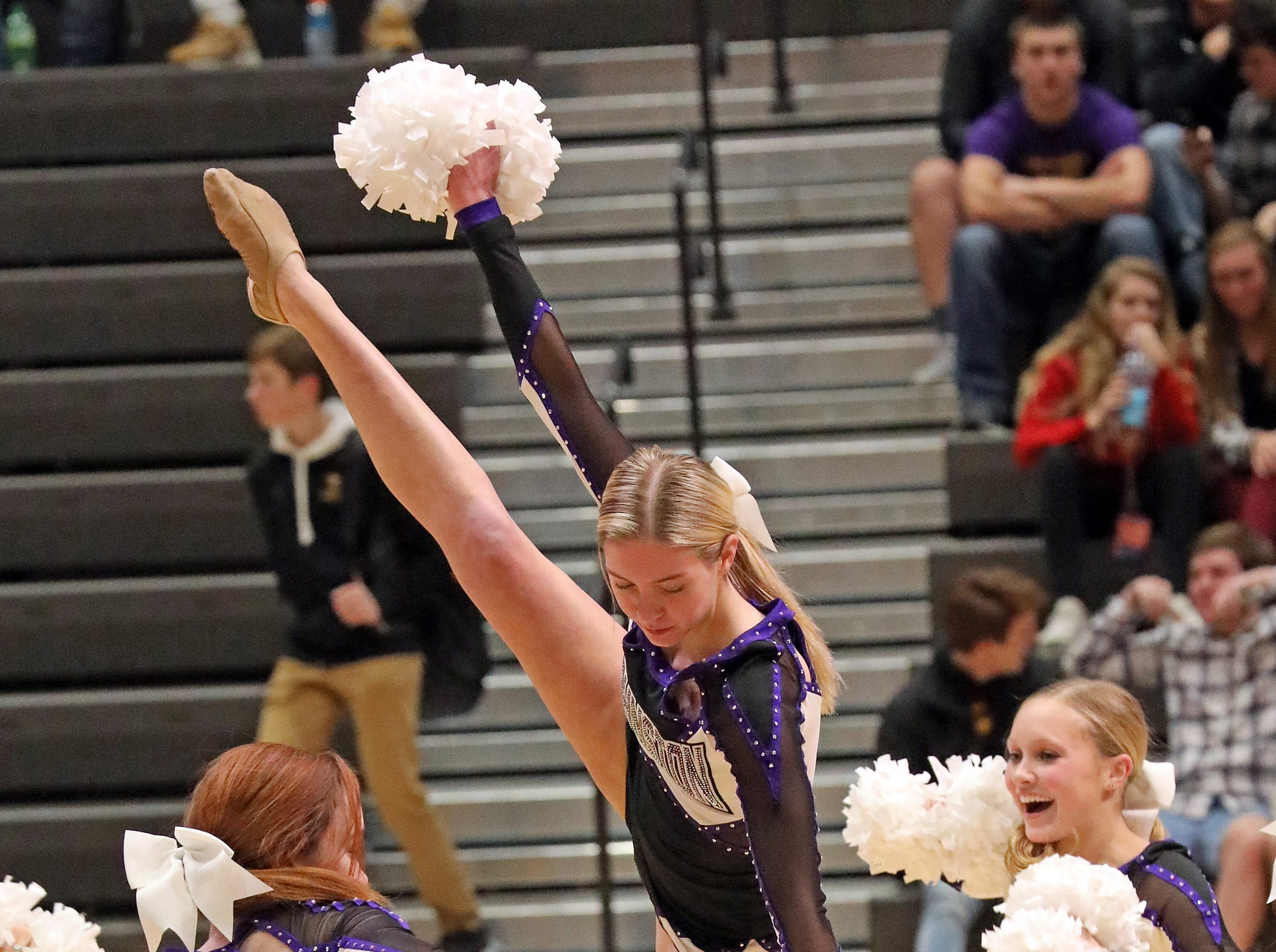 The Johnston dance team perform at half-time as the Ankeny Hawks compete against the Johnston Dragons in high school basketball on Friday, Dec. 21, 2018 at Johnston High School.