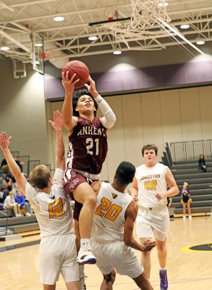 Ankeny sophomore JeRon Crews is called for charging as the Ankeny Hawks compete against the Johnston Dragons in high school basketball on Friday, Dec. 21, 2018 at Johnston High School.