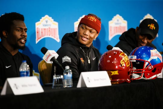 Iowa State's David Montgomery looks over at Brian Peavy as he speaks during a press conference on Wednesday, Dec. 26, 2018, in San Antonio. Iowa State takes on Washington State in the Valero Alamo Bowl on Friday.