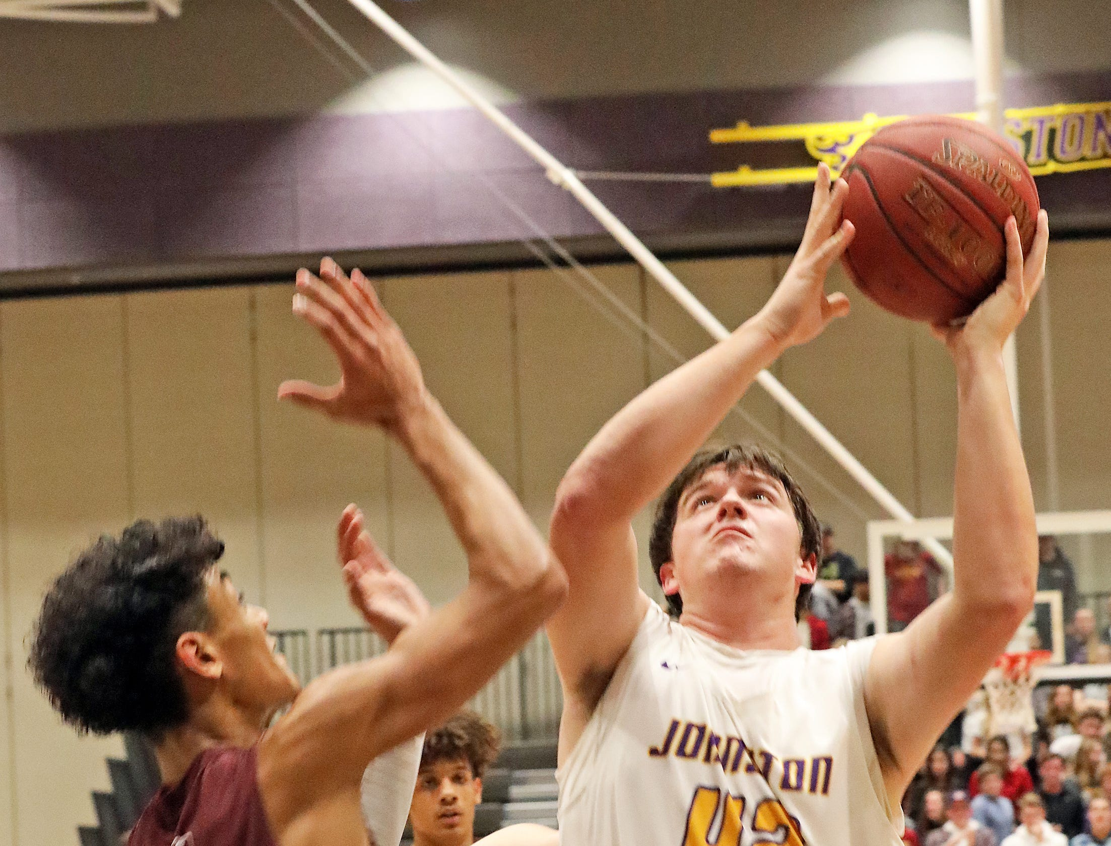 Johnston senior Peyton Williams fights down low as the Ankeny Hawks compete against the Johnston Dragons in high school basketball on Friday, Dec. 21, 2018 at Johnston High School.