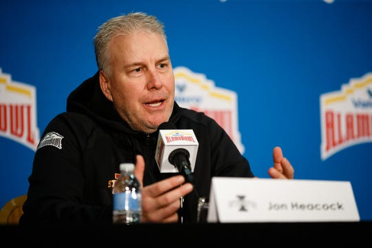 Iowa State defensive coordinator Jon Heacock talks to members of the press during an Alamo Bowl press conference.