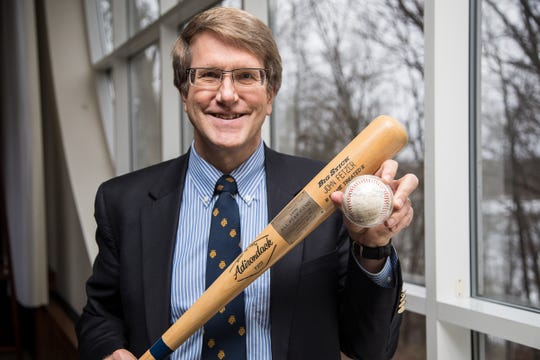 Bruce Fetzer, President & CEO of the John E. Fetzer Memorial Trust holds a baseball bat from the 1976 baseball All Star game and a baseball signed by the Detroit Tigers 1978 team at the Fetzer Institute in Kalamazoo, Tuesday, Nov. 20, 2018.