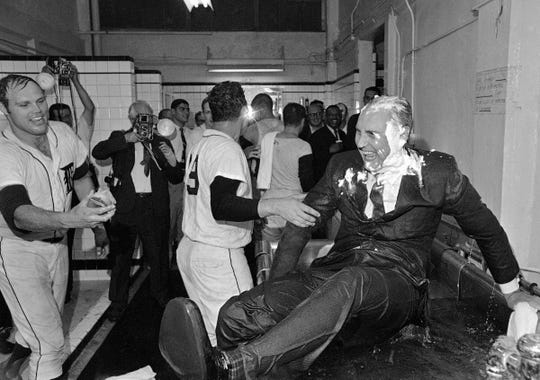 Doused with shaving cream, Detroit Tigers owner John E. Fetzer emerges from a whirlpool bath where he was tossed during a dressing room celebration after Detroit won the American League pennant on Sept. 17, 1968 in Detroit. At left catcher Bill Freehan advances with yet another can of shaving cream. Next to whirlpool is pitcher Mickey Lolich #29.