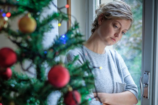 Woman Feeling Depressed During Christmas Days