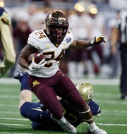 Minnesota running back Mohamed Ibrahim carries during the first half of the Quick Lane Bowl against Georgia Tech, Wednesday, Dec. 26, 2018, in Detroit.