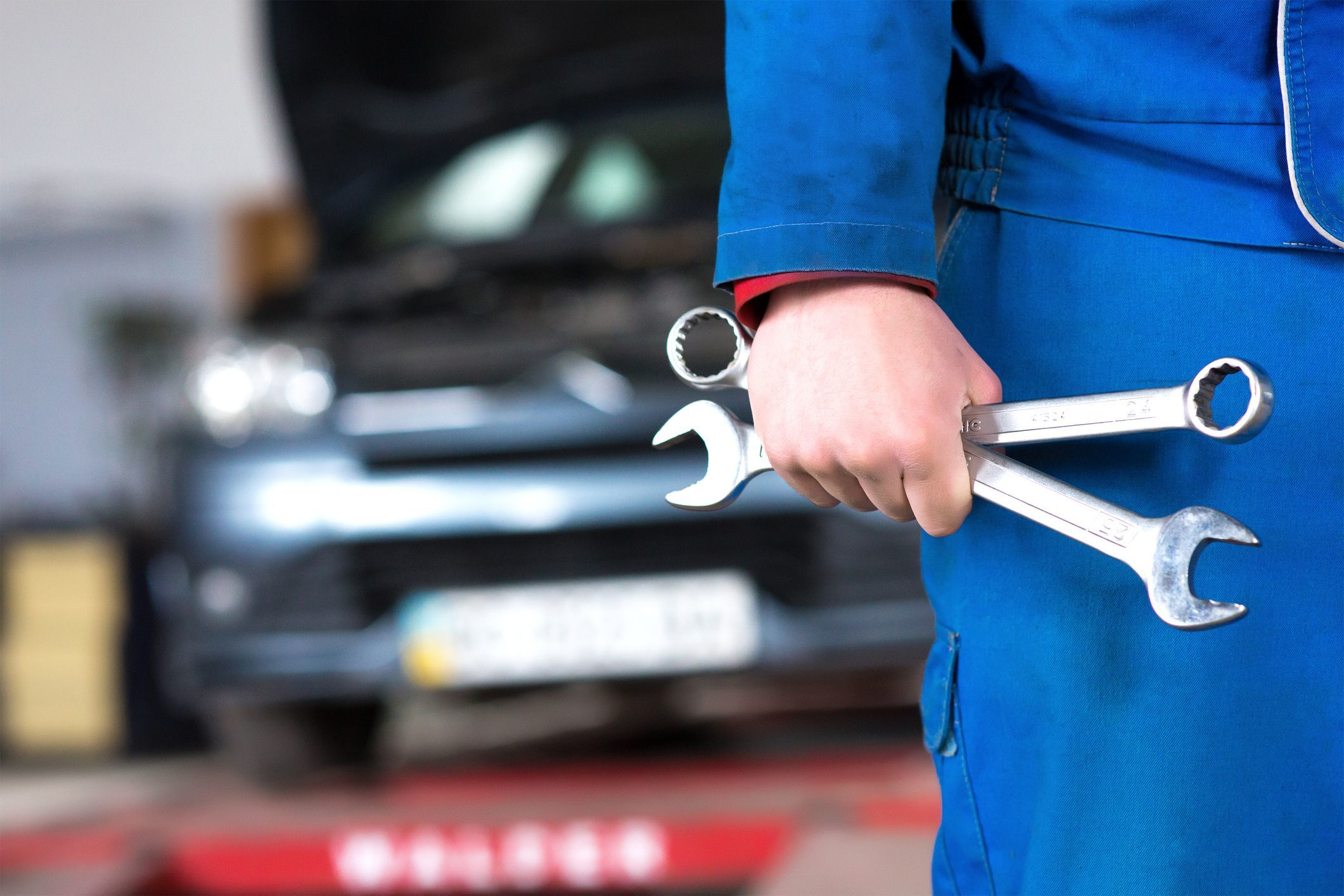Hand Of Car Mechanic With Wrench Auto Repair Garage