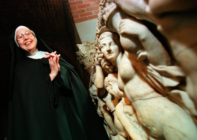 In this Thursday, Sept. 4, 1997, file photo, Sister Wendy Beckett, a Roman Catholic nun of the Sisters of Notre Dame, who lives in Colinton, England, and is a well-known art critic, stands near an unidentified sarcophagus at the Isabella Stewart Gardner Museum in Boston.