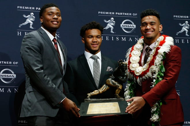 Oklahoma's Kyler Murray, left, and Alabama's Tua Tagovailoa pose for a photo at the press conference for the 2018 Heisman Trophy Presentation.