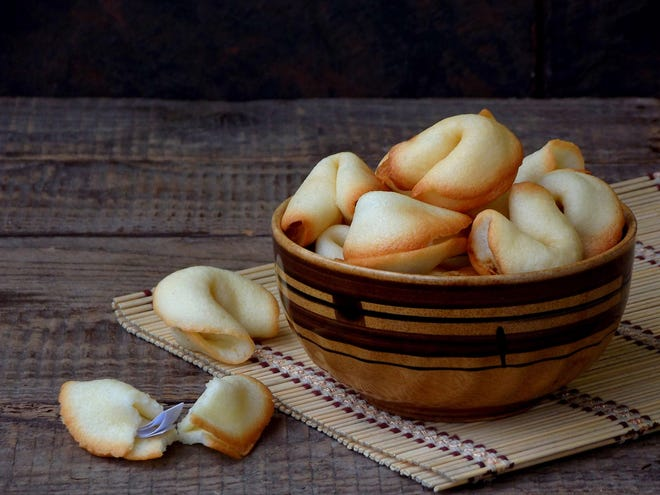 If you're looking for a creative food contribution for a New Year's fete, these fortune cookies are the answer. (Oksana Slepko/Dreamstime/TNS)