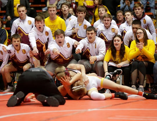 Luxemburg/Casco High School Wrestlers watch as  Issac Blohowiak competes against Carter Huppert of Ellsworth High School Saturday, March 3, 2018, in the 113 pound weight class of the WIAA division 2 state championship match in Madison, Wisconsin. Blohowiak won by major decision 14-6 and Luxemburg/Casco won the match 30-28. Doug Raflik/USA TODAY NETWORK-Wisconsin