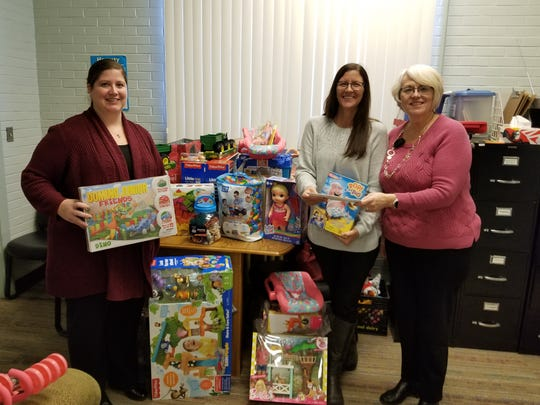 Femont Ag Credit staff deliver toys to Joyful Connections.