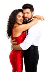 "Christie Prades as Gloria Estefan and Mauricio Martinez as Emilio Estefan in the musical ""On Your Feet!"""