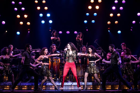 "Christie Prades (center) plays Gloria Estefan in the musical ""On Your Feet!"""