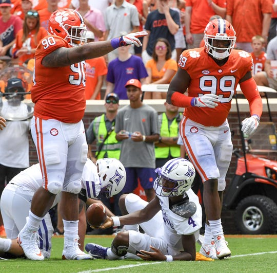 Clemson defensive lineman Dexter Lawrence (90) and defensive lineman Clelin Ferrell (99) stop Furman quarterback Darren Grainger (4) during the second quarter in Memorial Stadium in Clemson on Sept. 1.