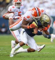 Clemson defensive lineman Christian Wilkins (42) tackles Georgia Tech quarterback TaQuon Marshall (16) during the 1st quarter at Georgia Tech's Bobby Dodd Stadium Saturday, September 22, 2018.