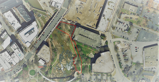 Just over half an acre of land next to the Reedy River in downtown Greenville was placed under permanent protection against development in December 2018. The area, shown here in red, had been part of the Camperdown development just off Main Street at the Reedy River bridge.