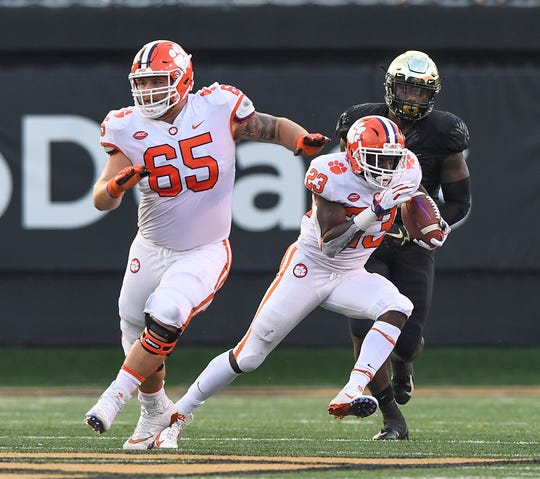 Clemson running back Lyn-J Dixon (23) carries against Wake Forest during the 4th quarter at BB&T Field in Winston Salem, N.C. Saturday, October 6, 2018.
