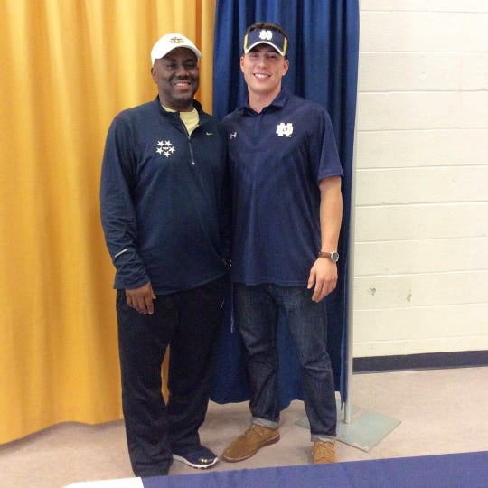 Ian Book (right) with TMP Elite coach Terrance Leonard on signing day in 2016