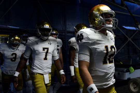 Fighting Irish quarterback Ian Book (12) takes the field before the game against the Navy Midshipmen at SDCCU Stadium.