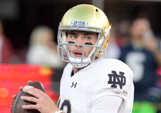 Notre Dame Fighting Irish quarterback Ian Book (12) during the game against the Southern California Trojans at Los Angeles Memorial Coliseum.