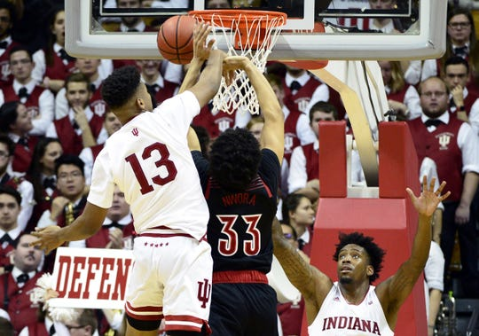 Hoosiers forward Juwan Morgan (13) blocks a shot from Louisville forward Jordan Nwora (33) during IU's narrow win.