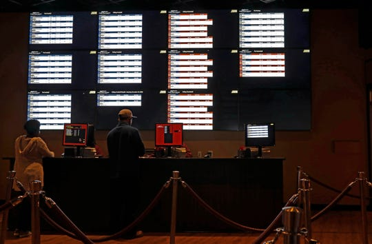 In this Dec. 18, 2018 photo, patrons place their wages at the Pearl River Resort, in Philadelphia, Miss. The sports book owned by the Mississippi Band of Choctaw Indians is the first to open on tribal lands outside of Nevada following a U.S. Supreme Court ruling earlier this year, a no-brainer business decision given the sports fans among its gambling clientele.