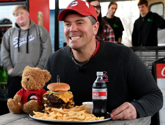 YouTube star Randy Santel prepares to take part in KC Finn's Big A** Burger challenge, Wednesday, December 26. Santel finished the challenge in 12:44.