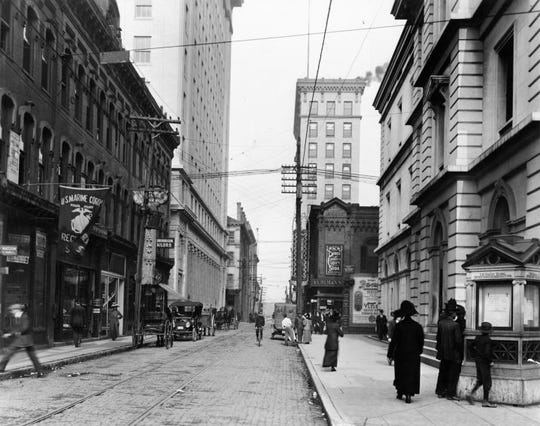 In this photo, taken roughly around 1916, a group of people (far right) look at information on a weather kiosk in downtown Knoxville. The kiosk currently sits at its original location on the corner of Market Street and Clinch Avenue, and it is believed to be the last one in the country.