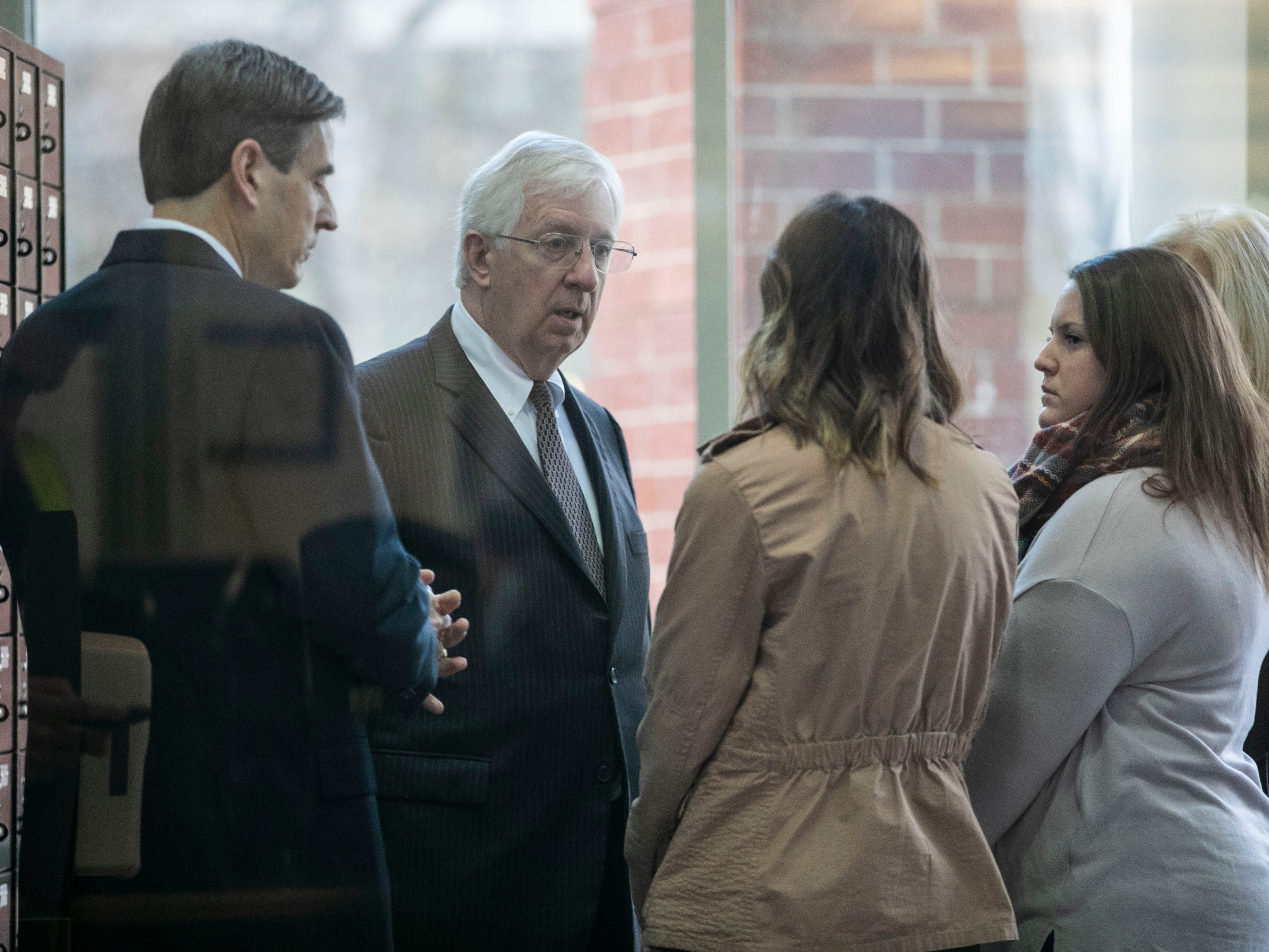 """Attorney David Lambertus talks to the family of Roger Burdette after arraignment Wednesday morning. A judge denied Lambertus' request to lower the $200,000 bond for Burdette. His next court date is set for January. Burdette is accused of killing Louisville Metro Police Detective Deidre """"Dee Dee"""" Mengedoht after ramming her stopped police car while he was driving an MSD semitruck on I-64 Christmas Eve. Dec. 26, 2018"""