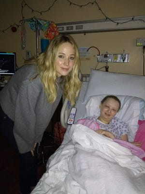 Jennifer Lawrence poses with Jubilee Divito, 15, at Norton Children's Hospital on Christmas Eve.
