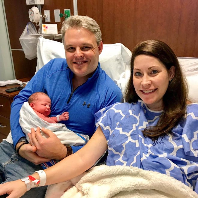 Alison Lundergan Grimes and her husband, Andrew, with their new son, Crawford.