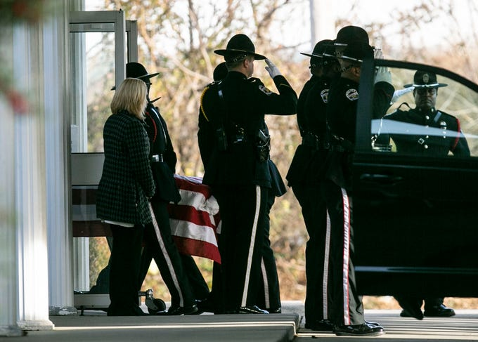 """Police carry the flag-draped body of Louisville Metro Police Detective Deidre """"Dee Dee"""" Mengedoht into the O.D. White funeral home on South Third Street Wednesday afternoon. Mengedoht was killed Christmas Eve after a semitruck driver crashed into her stopped police cruiser on I-64 in downtown Louisville. Dec. 26, 2018"""