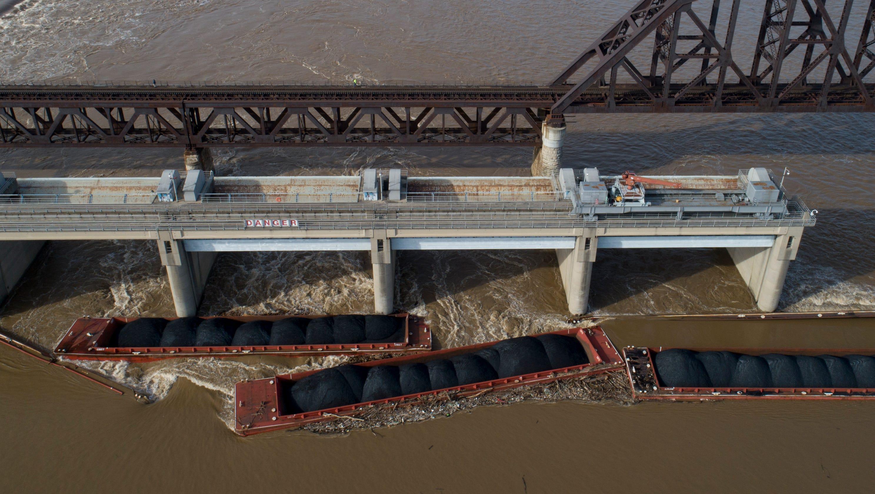 Ohio River barges sink in Louisville after bridge crash