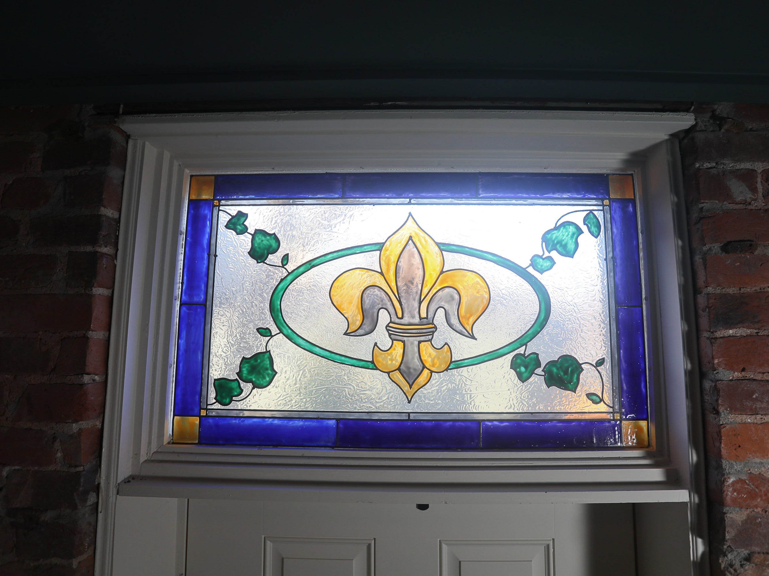 A stained glass transom over the entryway at the home of Kim Lesak in Louisville, KY. Dec. 18, 2018