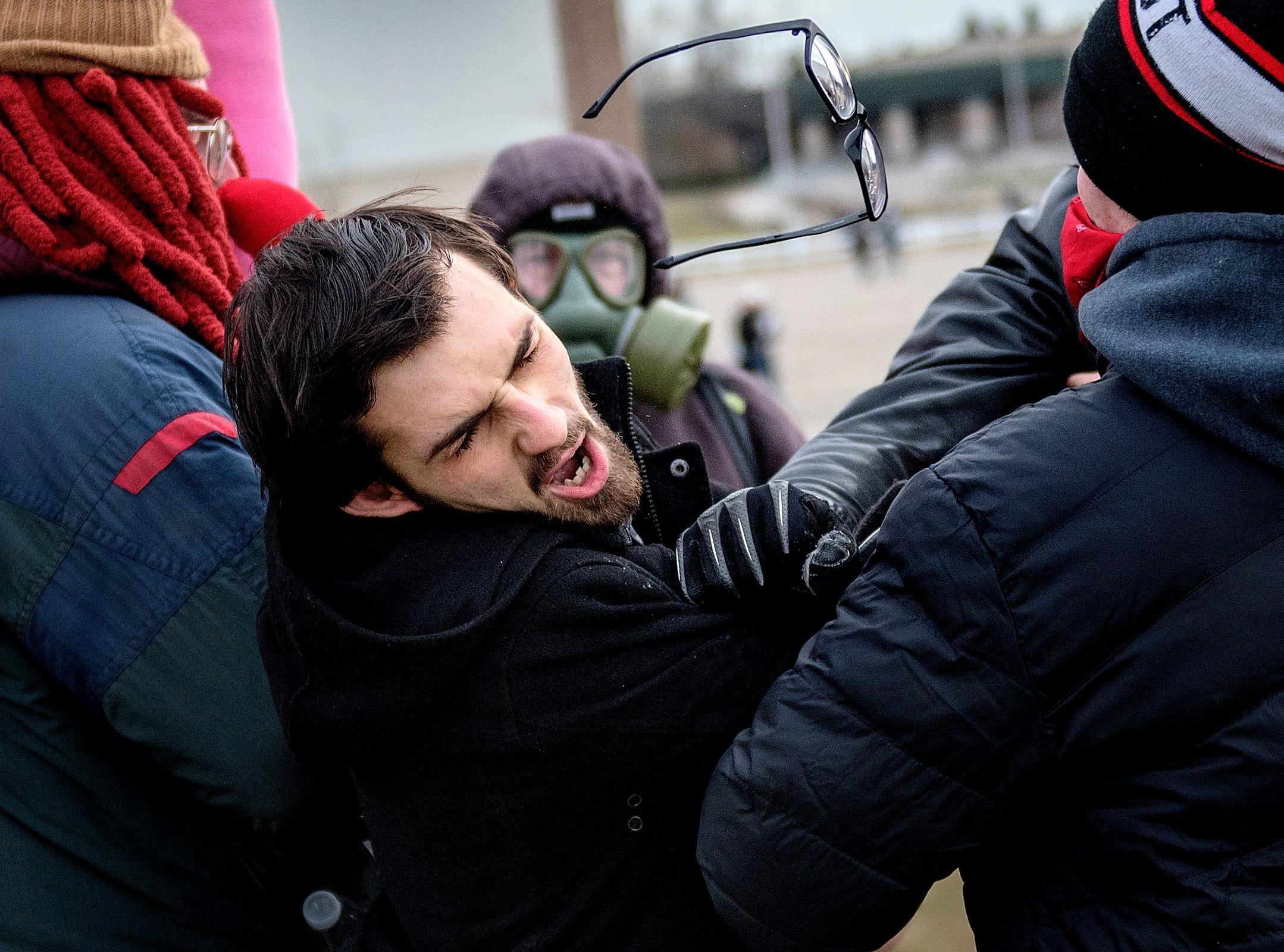 A man who was trying to enter the Richard Spencer speaking event is punched in the face by a protestor on Monday, March 5, 2018, outside the MSU Pavilion for Agriculture and Livestock Education in East Lansing.