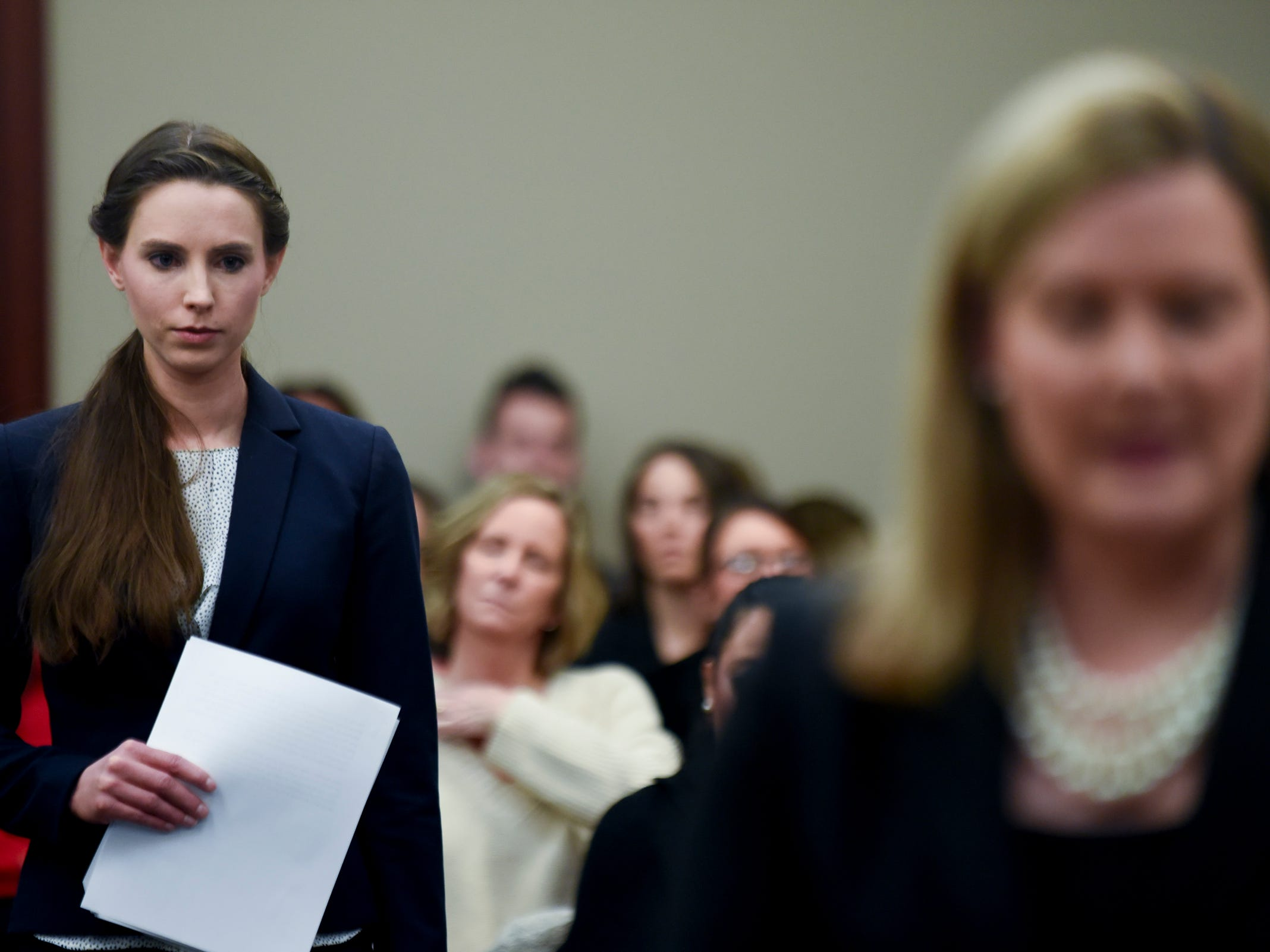 Rachael Denhollander, left, is introduced by Assistant Attorney General Angela Povaliatis, before she makes the final victim impact statement  Wednesday, Jan. 24, 2018, in Ingham County Circuit Court.