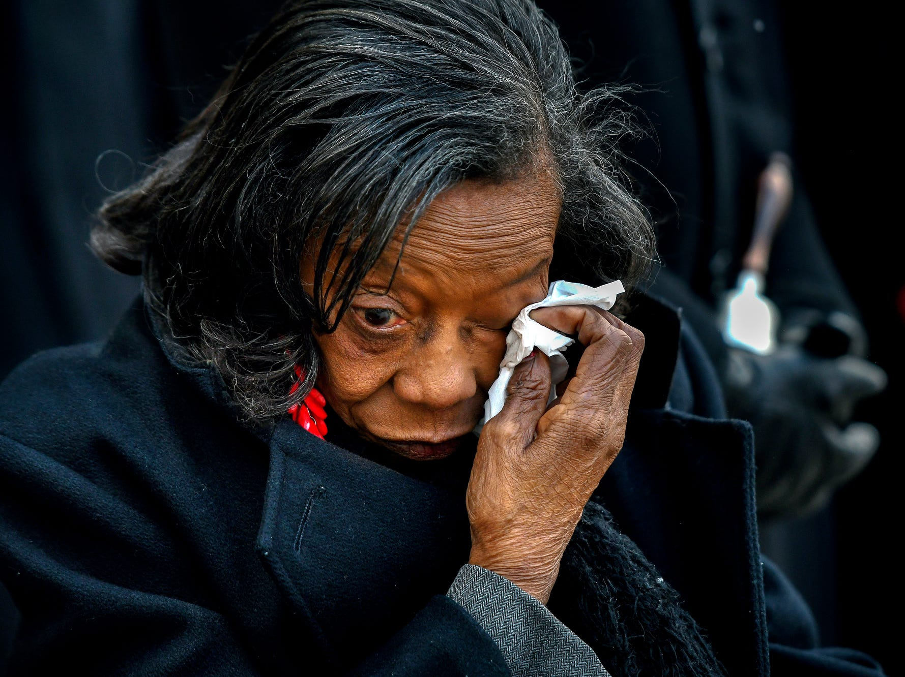 Mary Ellen Norwood Ford, an eye witness pictured in an iconic photo taken after Dr. Martin Luther King Jr.'s assassination, wipes tears from her eyes during the Ring a Bell for Freedom event on Wednesday, April 4, 2018, at the Michigan State Capitol in Lansing. Ford attended the event as the honored guest. The event, organized by the The Greater Lansing Area Dr. Martin Luther King Jr. Holiday Commission, commemorated the civil rights leader who was assassinated 50 years ago on this day.