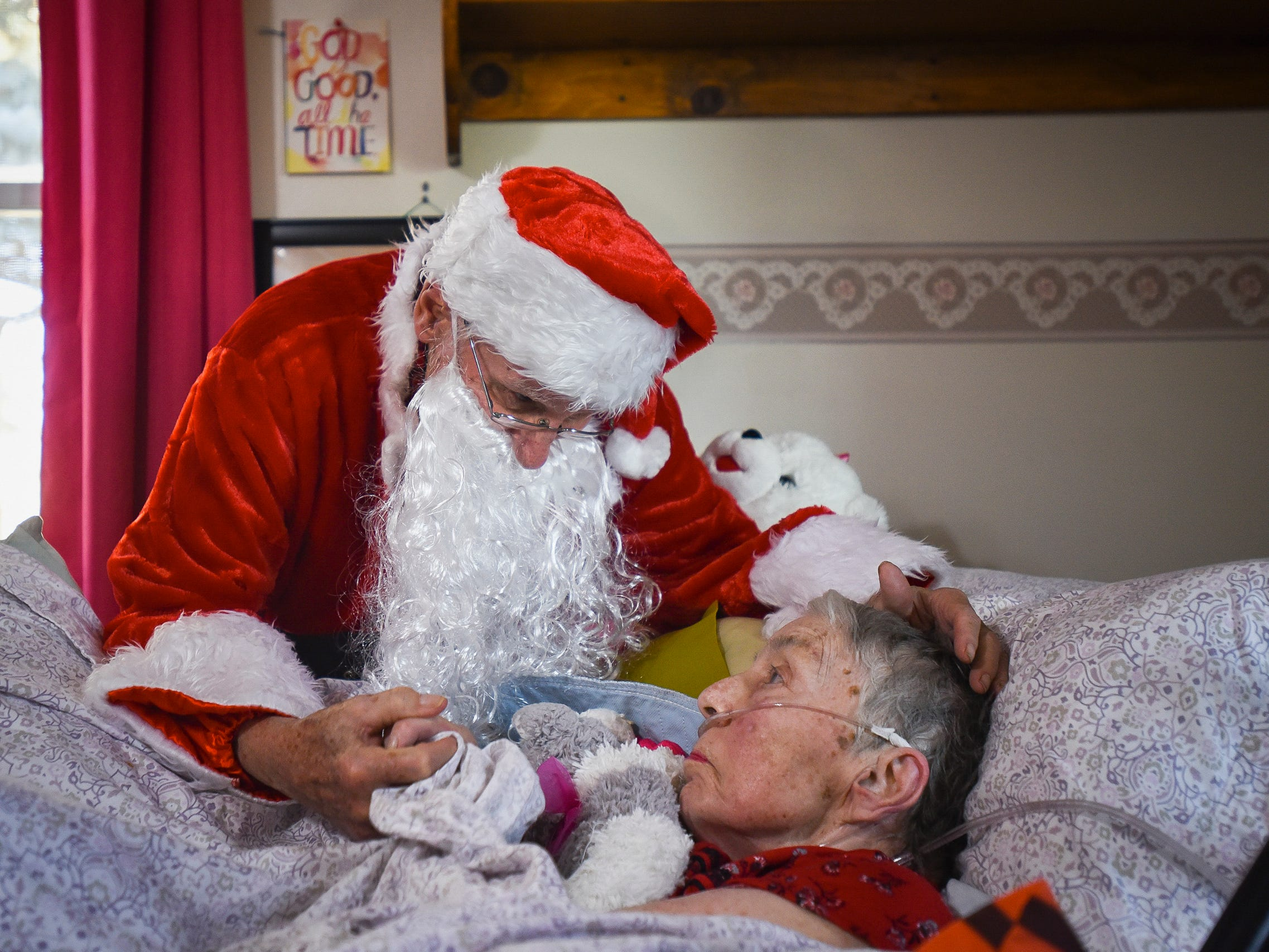 Don West, 90, of Eaton Rapids, leans in to kiss his wife Jackie goodnight, Saturday, Dec. 8, 2018, at Golden Days II Adult Foster Care in Charlotte following a Christmas party for residents and staff at the home.  Don hired a musician, brought gifts, and sang and danced for his wife of 64 years.  Jackie, who died Jan. 14, had been at the home since her stroke in June of 2017.